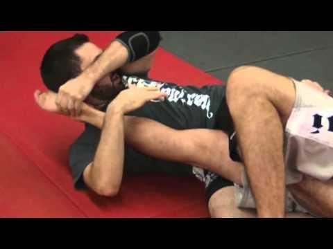 Бразильское джиу джитсу. Основы техники болевого приема - рычаг колена